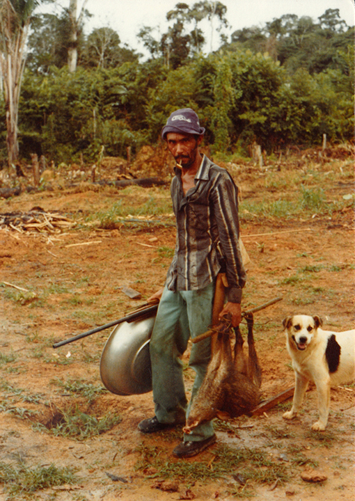 Amazon wild pig hunter in gold camp